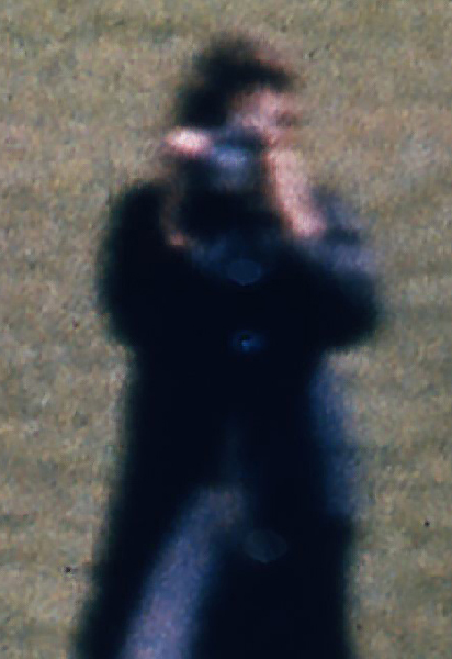 Figure in blue, head and upper chest, from frame 303 of the Zapruder film - after use of Focus Magic